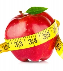 9105033 - red apple with measure tape on white background