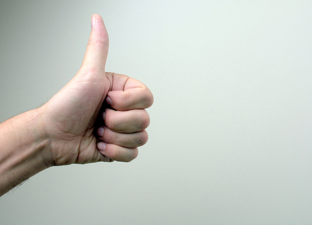 74004722 - hand showing sign on white background
