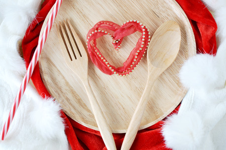 48357232 - heart shape on wooden dish with fork and spoon