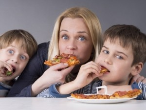 18816343 - hungry family, mother and son eating pizza