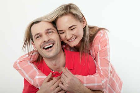 73609024 - cheerful young couple at home. woman and man hugs and kisses.