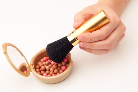 12766471 - makeup brush and rouge, white background