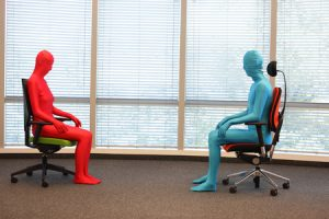 61315610 - anonymous couple in full body  elastic suits sitting on armchairs in sunny space
